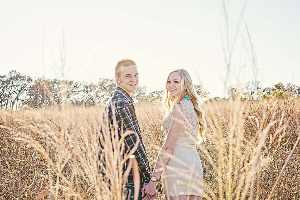 Love in the grass engagement shot at Cibolo Nature Center in Boerne Texas